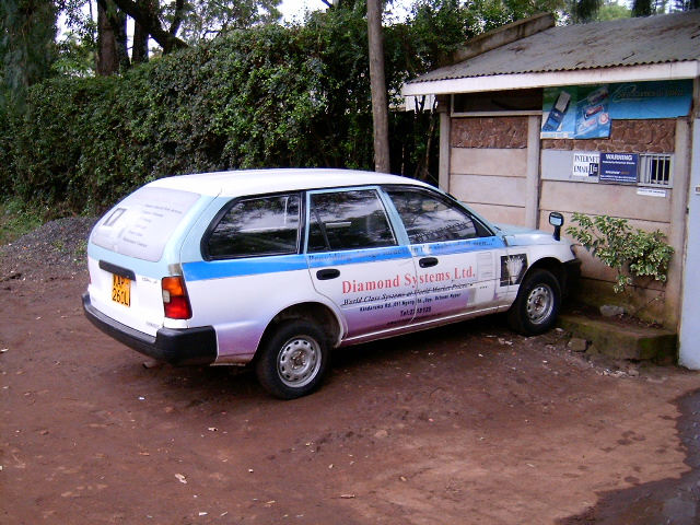 Our branded station wagon vehicle parked outside the gate